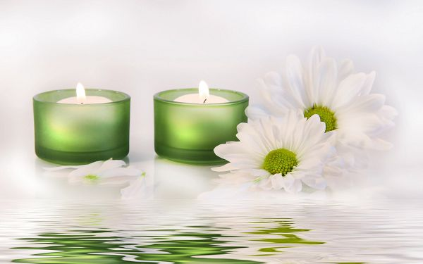 click to free download the wallpaper---White Flowers and Candles Surrounding, Water in Slow Flow, A Beautiful Woman Must be Around the Corner - HD Widescreen SPA Wallpaper