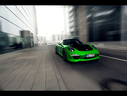 click to free download the wallpaper--World-Famous Cars Image, Green Porsche 911 in the Run, Combining Tech and Art