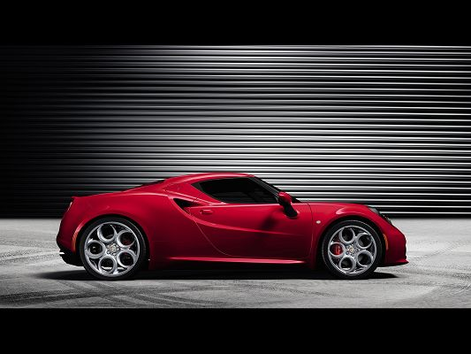click to free download the wallpaper--World-Famous Super Cars Image of Red Alfa Romeo 4C Just Out from Its Garage, Expect Its Speed