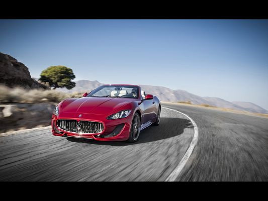 click to free download the wallpaper--World-Known Car Images of Maserati GranCabrio, the Decent Car Turning a Corner, Speed is Never Minused