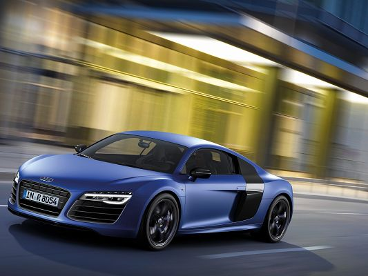click to free download the wallpaper--World-Known Super Car Pics of Audi R8, a Blue Car in Great Speed, Along Scenes Rushing Behind