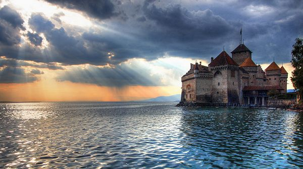 click to free download the wallpaper--beautiful pictures of nature - An Old Castle by the Seaside, Thick Clouds Over It, Sunlight Breaking in