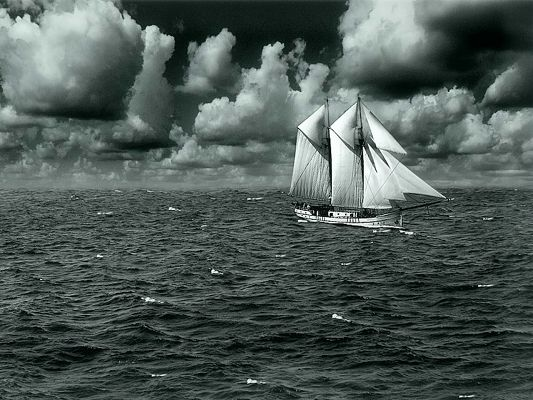 Free Wallpaper Of A Boat Sailing On The Sea