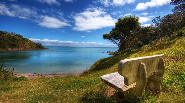 click to free download the wallpaper--landscape photos - The Sky and the Sea in the Same Color, a Stone Chair, an Impressive Scene