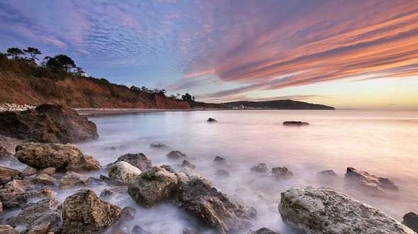 click to free download the wallpaper--landscape picture - Misty River Behind the Pink Sky, Stones Are by the Beachside