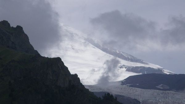 natural photos - A Snow-Capped Mountain, Smoke is Pouring, is a Fire Breaking Out?
