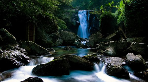 photo of nature - The Blue River and a Waterfall, Natural Plants Alongside, an Impressive Scene