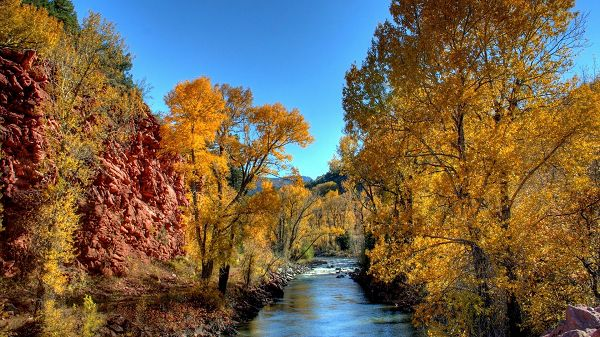 click to free download the wallpaper--sceneries pictures - The Yellow Trees and Blue River, Red and Tough Hills, What a Natural Scene!