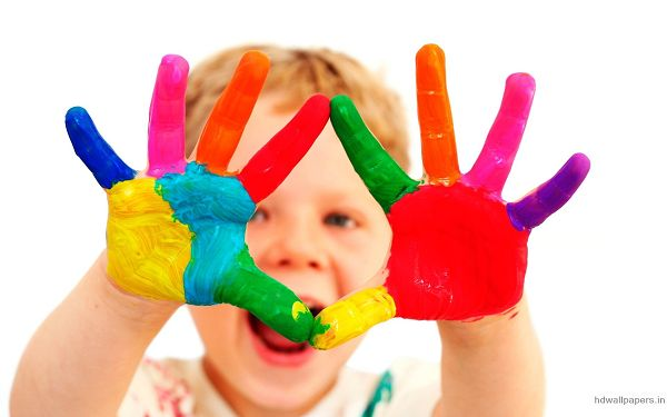 Wallpaper Of Baby-a Cute Boy With Colorful Fingers