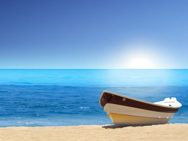 wallpaper of beach: a small boat on the beautiful beach ,click to download