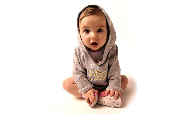 Wallpaper Of Lovely Baby: A Cute Baby Boy Wearing A Light Brown Sweater