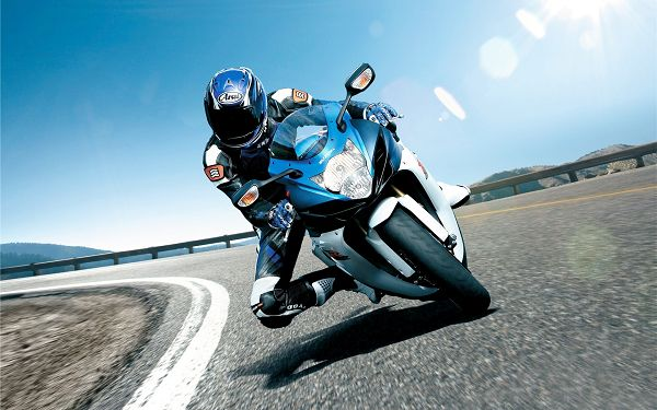 wallpaper of motorcycle: a biker on Suzuki motorcycle ,click to download