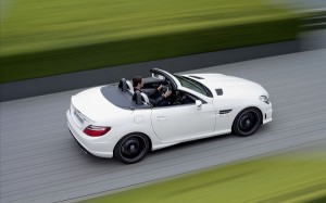 White Benz SLK55 Car Being Driven at an Incredible Speed, the Scenes Alongside are Rushing Behind, What a Car! - HD Cars Wallpaper
