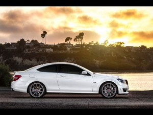Super Car Images of Mercedes-Benz C63, a White Car in Front of the Sea, the Golden Sky